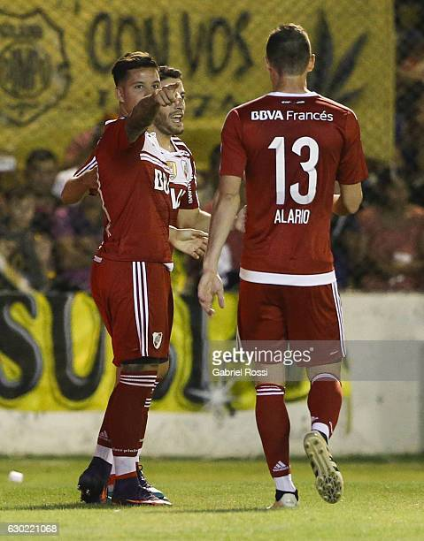 Sebastian Driussi of River Plate celebrates with teammates Lucas Alario and Camilo Mayada after scoring the second goal of his team during a match...