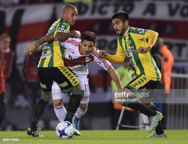 Sebastian Driussi of River Plate fights for ball with Roberto Brum Gutierrez and Alan Alegre of Aldosivi during a match between River Plate and...