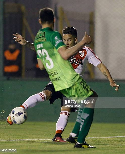 Sebastian Driussi of River Plate kicks the ball to score the third goal of his team during a match between Defensa y Justicia and River Plate as part...
