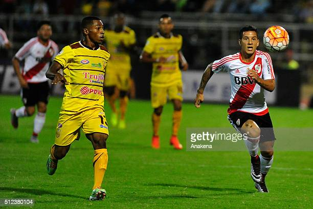 Sebastian Driussi of River Plate struggles for the ball with Manuel Granados of Trujillanos during a group stage match between Trujillanos and River...