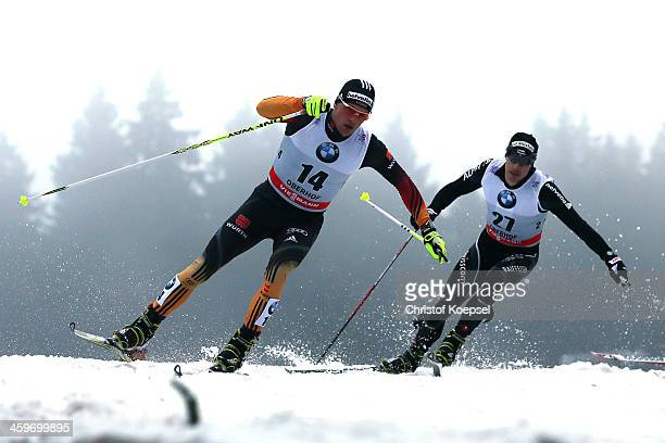 Sebastian Eisenlauer of Germany leads in front of Gianluca Cologna of Switzerland during the Men's 15km second quarterfinal free sprint at the...