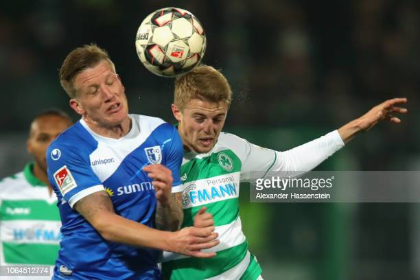 Sebastian Ernst of Fuerth battles for the ball with Richard Weil of Magdeburg during the Second Bundesliga match between SpVgg Greuther Fuerth and 1...