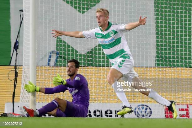 Sebastian Ernst of Fuerth celebrates scoring the opning goal during the DFB Cup first round match between SpVgg Greuther Fuerth and BVB Borussia...