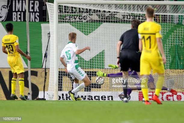 Sebastian Ernst of Fuerth scores the opening goal during the DFB Cup first round match between SpVgg Greuther Fuerth and BVB Borussia Dortmund at...