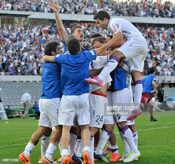 Sebastian Fernandez of Nacional and his teammates celebrate after scoring the opening goal during a match between Nacional and Peñarol as part of...