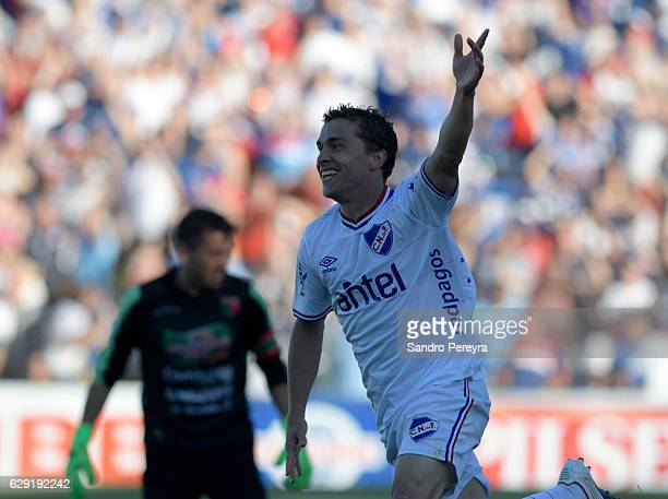 Sebastian Fernandez of Nacional celebrates after scoring the first goal of his team during a match between Nacional and Boston River as part of...
