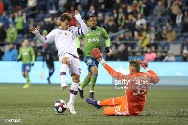 Sebastian Fernandez of the Club Nacional dribbles with the ball against Bryan Meredith of Seattle Sounders during their game at CenturyLink Field on...