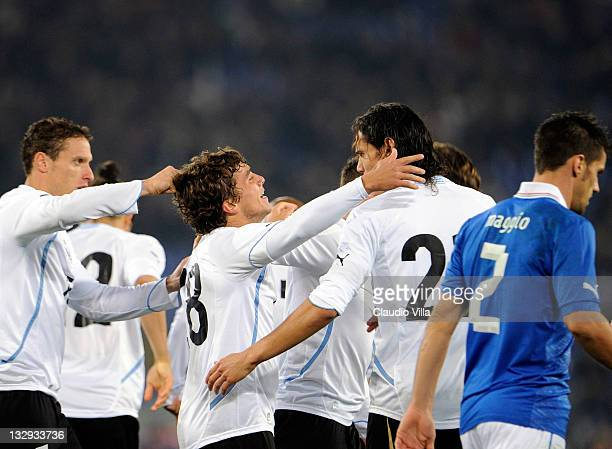 Sebastian Fernandez of Uruguay celebrates with teammates after scoring the opening goal of the international friendly match between Italy and Uruguay...