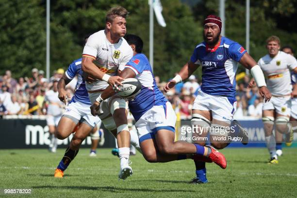 Sebastian Ferreira of Germany is challenged by Ahsee Tuala of Samoa during the Germany v Samoa Rugby World Cup 2019 qualifying match on July 14 2018...