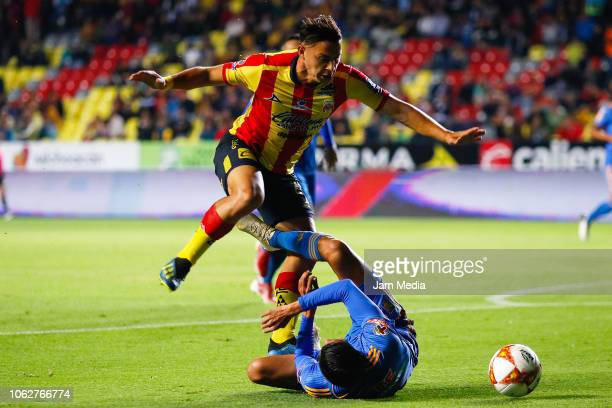 Sebastian Ferreira of Morelia fights for the ball with Hugo Ayala of Tigres during the 15th round match between Morelia and Tigres UANL as part of...