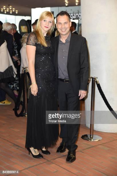 Sebastian Fitzek and his wife Sandra Fitzek attend the Deutscher Radiopreis at Elbphilharmonie on September 7 2017 in Hamburg Germany