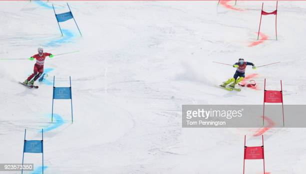 Sebastian FossSolevaag of Norway and Dave Ryding of Great Britain compete during the Alpine Team Event Quarterfinals on day 15 of the PyeongChang...