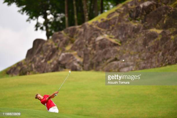 Sebastian Friedrichsen of Denmark hits his second shot on the 16th hole on the first round of the Toyota Junior Golf World Cup at Chukyo Golf Club...