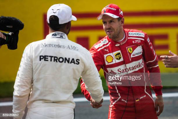 Sebastian from Germany of scuderia Ferrari greeting 44 HAMILTON Lewis from Great Britain of team Mercedes GP about his pole position during the...