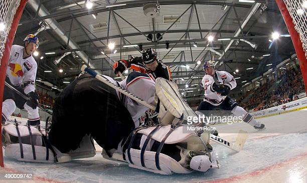 Sebastian Furchenr of Wolfsburg scores his team's opening goal during the DEL match between Grizzly Adams Wolfsburg and EHC Red Bull Muenchenb at...