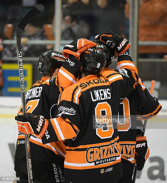 Sebastian Furchner Jeffrey Likens and Tyler Haskins of the Grizzlys Wolfsburg celebrate after scoring the 62 during the game between the Grizzlys...