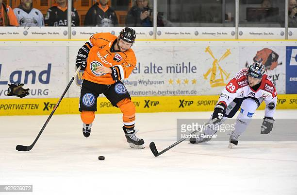 WOLFSBURG GERMANY FEBRUARY 01 Sebastian Furchner of the Grizzly Adams Wolfsburg and Jens Baxmann of the Eisbaeren Berlin during the game between...