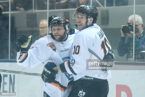 Sebastian Furchner of the Grizzlys celebrates his goal with teammate Tyler Haskins during the DEL PlayOffs Final Match 1 between EHC Muenchen and...
