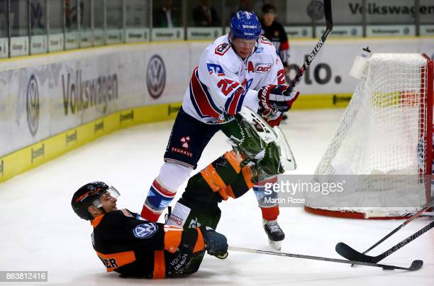 Sebastian Furchner of Wolfsburg and Denis Reul of Mannheim battle for the puck during the DEL match between Grizzlys Wolfsburg and Adler Mannheim at...