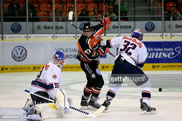 Sebastian Furchner of Wolfsburg and Frederic St Denis of Muenchen battle for the puck during the DEL match between Grizzly Adams Wolfsburg and EHC...