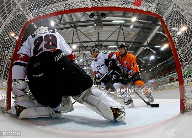 Sebastian Furchner of Wolfsburg battles for position with Shawn Lalonde of Koeln during the DEL match between Grizzly Wolfsburg and Koelner Haie at...