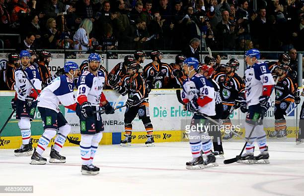 Sebastian Furchner of Wolfsburg celebrates after scoring his team's 3rd goal in game four of the DEL semi final playoffs between Grizzly Adams...