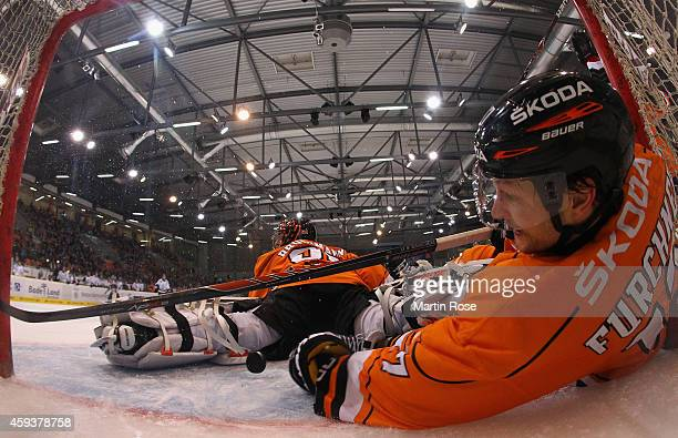 Sebastian Furchner of Wolfsburg tries to stop the puck in front of the net during the DEL match between Grizzly Adams Wolfsburg and Thomas Sabo Ice...