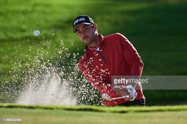 Sebastian Garcia Rodriguez of Spain chips out of the bunker onto the 17th green during day 3 of the Challenge Tour Grand Final at Club de Golf...