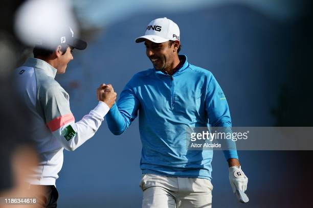 Sebastian Garcia Rodriguez of Spain shakes hands with Rhys Enoch of Wales on the sixteenth green during day 2 of the Challenge Tour Grand Final at...