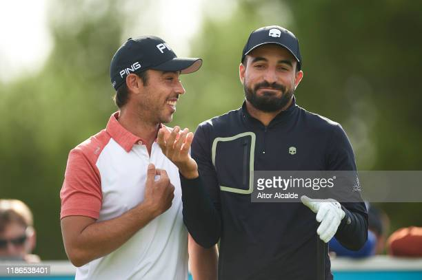 Sebastian Garcia Rodriguez of Spain talks with Francesco Laporta of Italy during day 3 of the Challenge Tour Grand Final at Club de Golf Alcanada on...