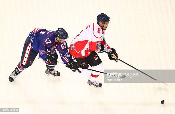 Sebastian Geoffrion of the USA and Sean McMonagle of Canada contest possession during the International Ice Hockey Series between the United States...