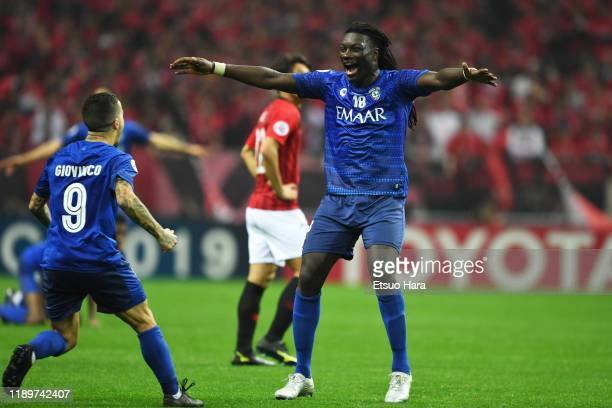 Sebastian Giovinco and Bafetibi Gomis of Al Hilal celebrate the victory at the end of the AFC Champions League Final second leg match between Urawa...
