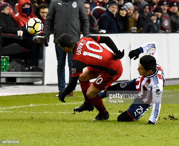 Sebastian Giovinco battles for the ball with Michael Prez of Chivas Guadalajara during the CONCACAF Champions League Final Leg 1 on April 17 2018 at...