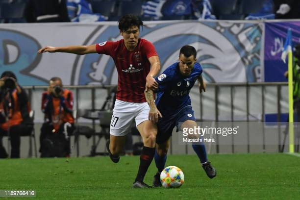 Sebastian Giovinco of Al Hilal and Daiki Hashioka of Urawa Reds compete for the ball during the AFC Champions League Final second leg match between...