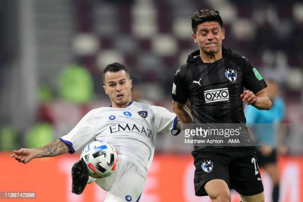 Sebastian Giovinco of Al Hilal and Jonathan Gonzalez of CF Monterrey during the FIFA Club World Cup Qatar 2019 Third Place Play Off match between...