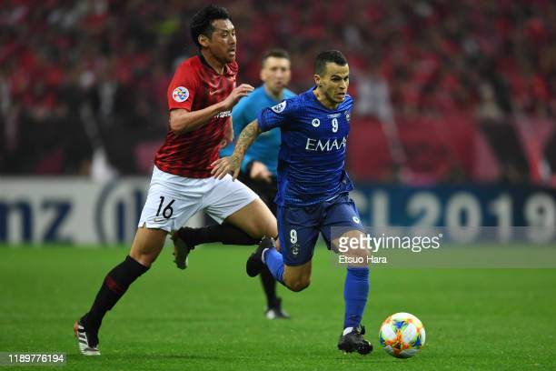 Sebastian Giovinco of Al Hilal and Takuya Aoki of Urawa Red Diamonds compete for the ball during the AFC Champions League Final second leg match...