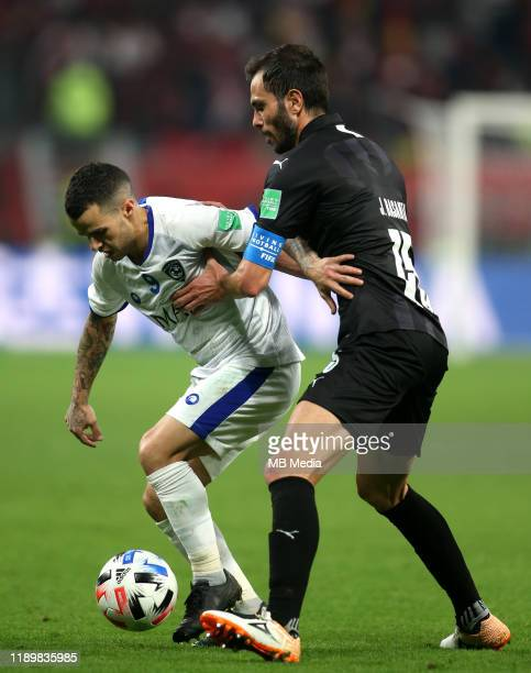 Sebastian Giovinco of Al Hilal competes for the ball with José Basanta of Monterrey during the FIFA Club World Cup match for third place between...