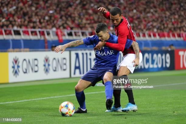 Sebastian Giovinco of Al Hilal controls the ball under pressure of Ewerton of Urawa Red Diamonds during the AFC Champions League Final second leg...