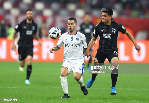 Sebastian Giovinco of Al Hilal FC looks to break past Jonathan González of Monterrey during the FIFA Club World Cup Qatar 2019 3rd place match...