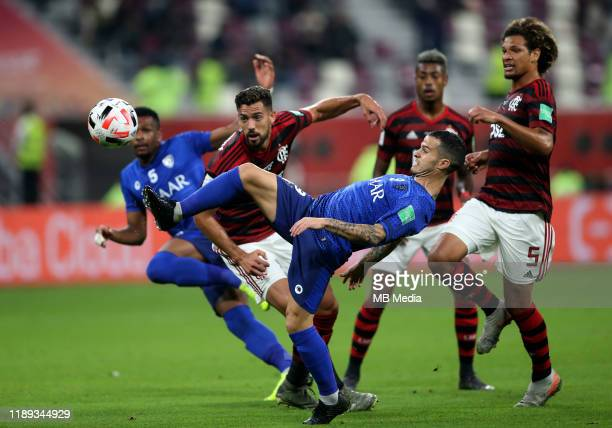 Sebastian GIOVINCO of Al Hilal SFC competes for the ball with Pablo Mari and William Arao of CR Flamengo during the SemiFinals Match CR Flamengo and...