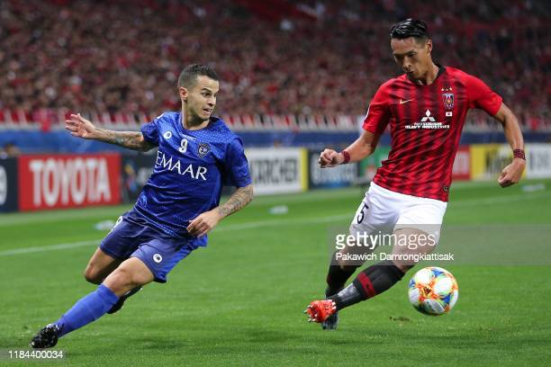 Sebastian Giovinco of Al Hilal takes on Tomoaki Makino of Urawa Red Diamonds during the AFC Champions League Final second leg match between Urawa Red...