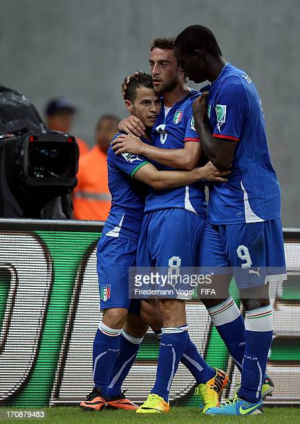 Sebastian Giovinco of Italy celebrates with teammates Mario Balotelli and Claudio Marchisio during the FIFA Confederations Cup Brazil 2013 Group A...
