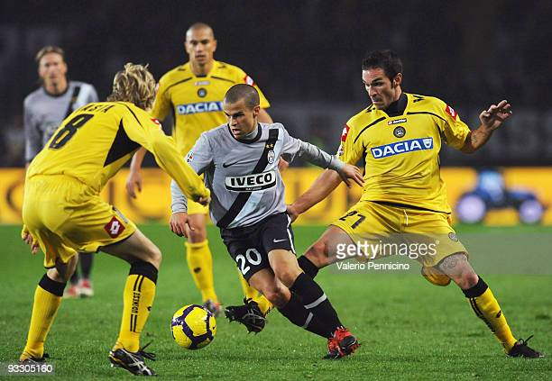 Sebastian Giovinco of Juventus FC is challenged by Gaetano D'agostino and Dusan Basta of Udinese Calcio during the Serie A match between Juventus and...