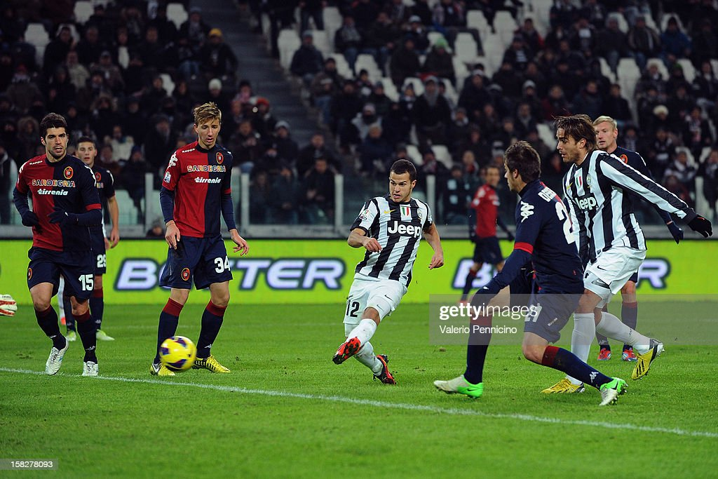 Sebastian Giovinco (C) of Juventus FC scores the opening goal during the TIM Cup match between Juventus FC and Cagliari Calcio at Juventus Arena on December 12, 2012 in Turin, Italy.
