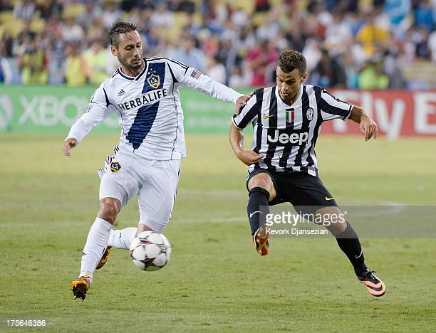 Sebastian Giovinco of Juventus in action against AJ De La Garza of Los Angeles Galaxy during 2013 Guinness International Champions Cup at Dodger...