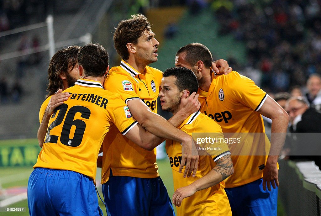 Sebastian Giovinco of Juventus is mobbed by team mates after scoring his team's opening goal during the Serie A match between Udinese Calcio and Juventus at Stadio Friuli on April 14, 2014 in Udine, Italy.