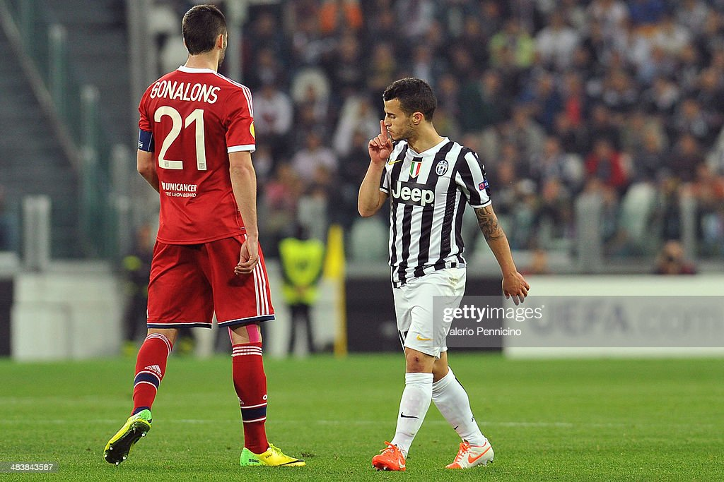 Sebastian Giovinco (R) of Juventus reacts to Maxime Gonalons of Olympique Lyonnais durig the UEFA Europa League quarter final match between Juventus and Olympique Lyonnais at Juventus Arena on April 10, 2014 in Turin, Italy.