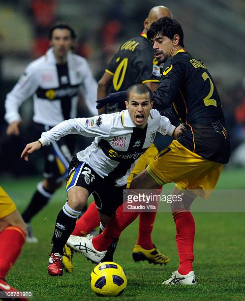 Sebastian Giovinco of Parma FC and Carlos Grossmuller of Lecce compete for the ball during the Serie A match between Parma FC and Lecce at Stadio...