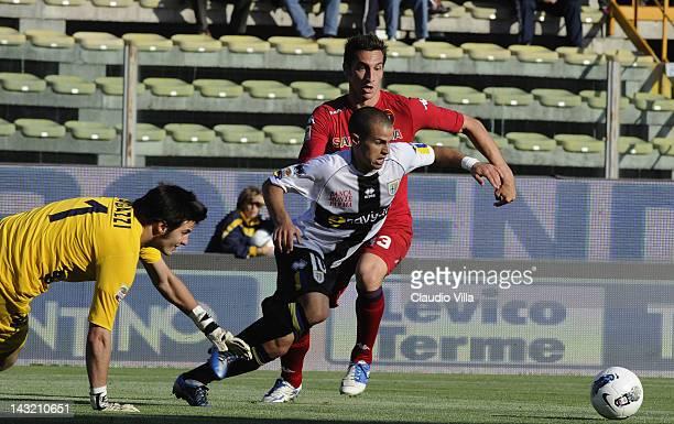 Sebastian Giovinco of Parma FC and Davide Astori of Cagliari Calcio compete for the ball during the Serie A match between Parma FC and Cagliari...