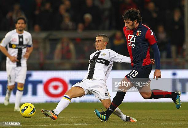 Sebastian Giovinco of Parma FC competes for the ball with Kakha Kaladze of Genoa CFC during the Serie A match between Genoa CFC and Parma FC at...